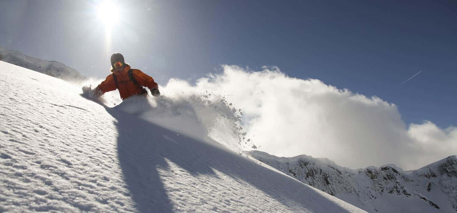 Guy Snowboarding on Mountain