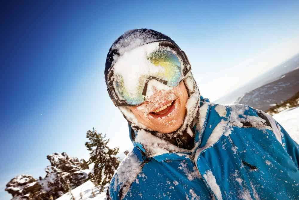 Snow on Snowboard Goggles