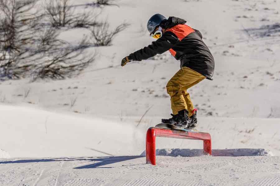 Snowboarder Doing A Boardslide